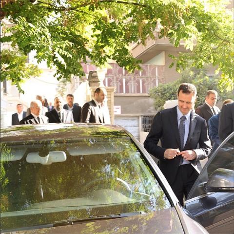 President Assad after Eid al-Fitr prayers on August 8. 2013.