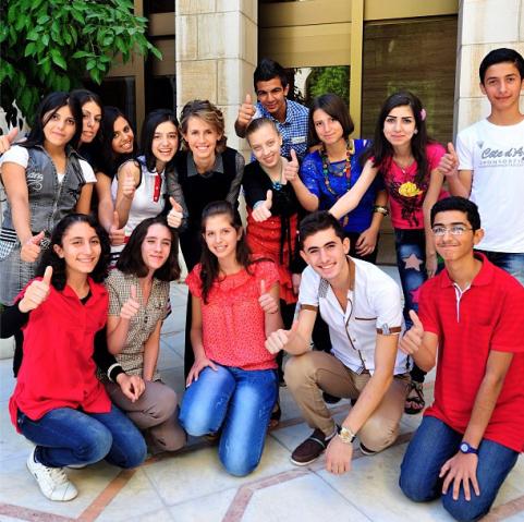 Asma Assad with students, September 2012.