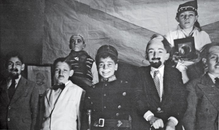 Jorge Mario Bergoglio, front row, second left, dressed as a waiter in a jacket and black bow tie during a school theater presentation.