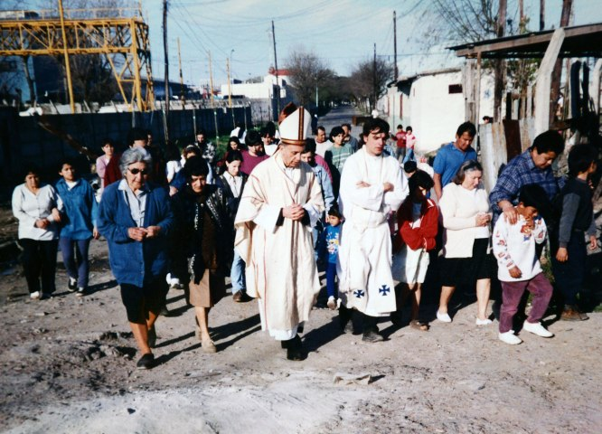Bishop Jorge Mario Bergoglio, center, accompanied by Father Jose Maria de Paola and local residents during a visit to the Villa 21-24 shanty town in Buenos Aires in 1998.