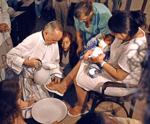 The archbishop of Buenos Aires, Cardinal Jorge Bergoglio, washes a woman's feet on Holy Thursday at the Buenos Aires' Sarda maternity hospital, March 24, 2005.