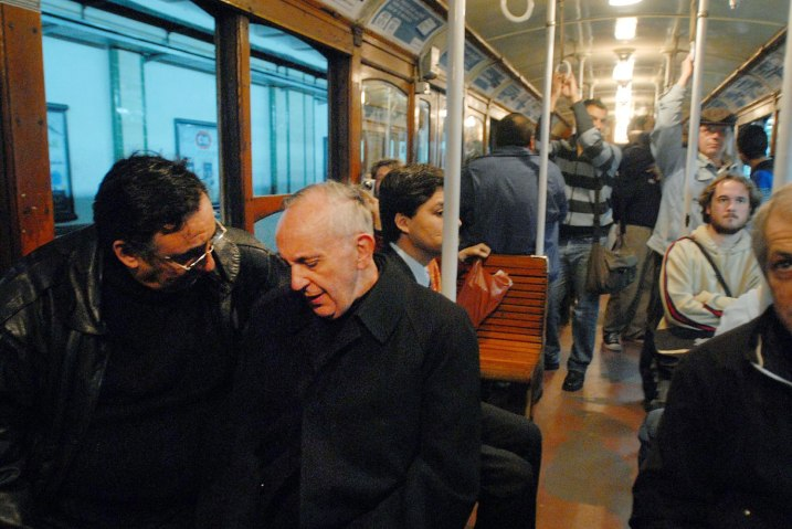 Jorge Mario Bergoglio speaks with a man while riding the Subterraneo in Buenos Aires, May 24, 2008.