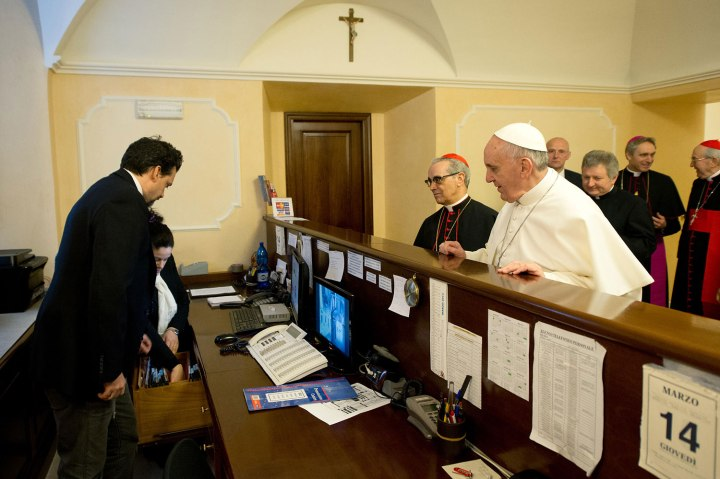 Newly elected Pope Francis I, Cardinal Jorge Mario Bergoglio of Argentina, checks out of the church-run residence where he had been staying in Rome