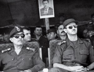 President-elect Lt. Gen. Bashar Assad, right, attends military training games in Syria, July 12, 2000.